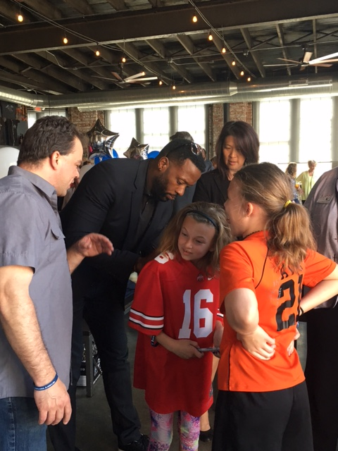 Jay Richardson, NFL great and Buckeye, signs the jersey's of fans!